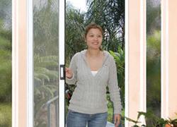 Women Opening Screen, Window And Door Screens, New York NY
